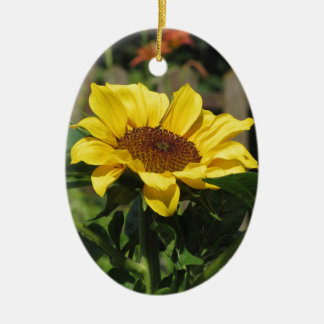 Single yellow sunflower with green leaves ceramic ornament