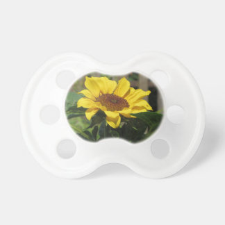 Single yellow sunflower with green leaves dummy