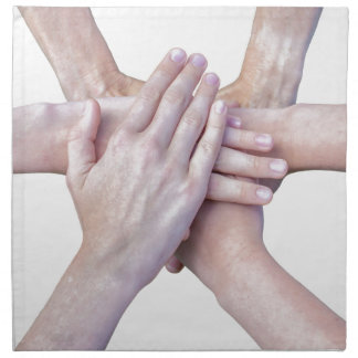 Six arms unite with hands on each other napkin