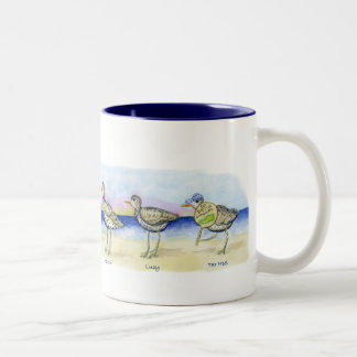 six sandpipers on a mug