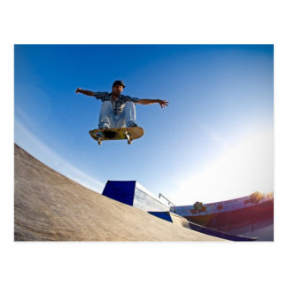 Skateboarder flying postcard