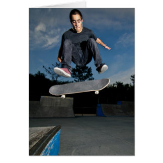Skateboarder on a flip trick card