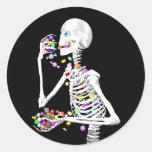 Skeleton Eating Halloween Candies. Round Sticker