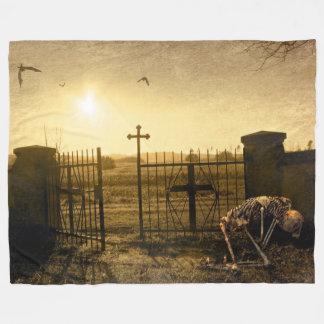 Skeleton in cemetery fleece blanket
