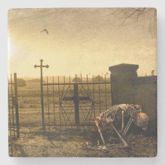 Skeleton in cemetery stone coaster