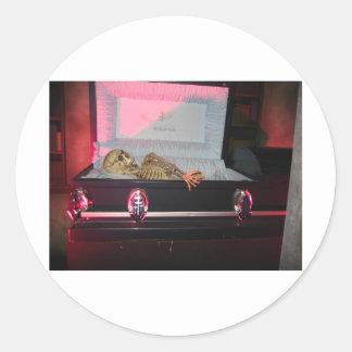 skeleton in coffin classic round sticker