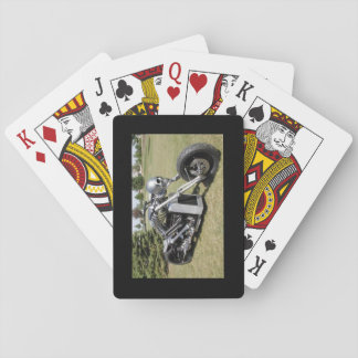 Skeleton motorcycle on a deck of playing cards