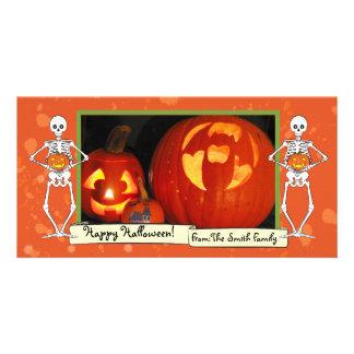 Skeletons holding pumpkins photo card