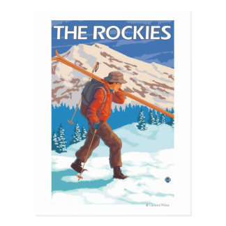 Skier Carrying Snow Skis - The Rockies Postcard