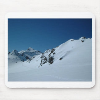 Skiing in the mountains mouse pad