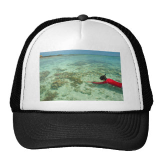 Skindiver swimming in a tropical sea trucker hat