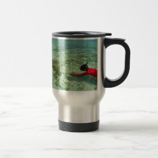 Skindiver swimming in a tropical sea travel mug