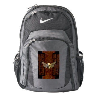 Skull with wings on dark background backpack
