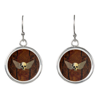 Skull with wings on dark background earrings