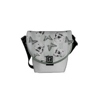 Skulls and butterflies courier bag