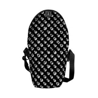 Skulls on black background commuter bag