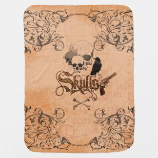 Skulls with crow receiving blanket