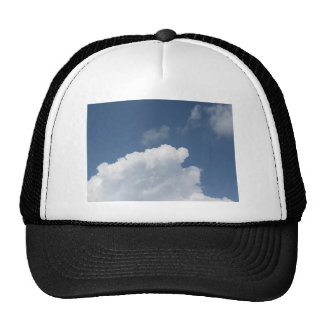 Sky with giants clouds and sun rays through cap