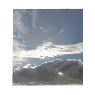 Sky with giants cumulonimbus clouds and sun rays notepad
