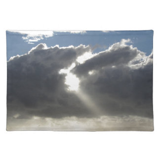 Sky with giants cumulonimbus clouds and sun rays placemat
