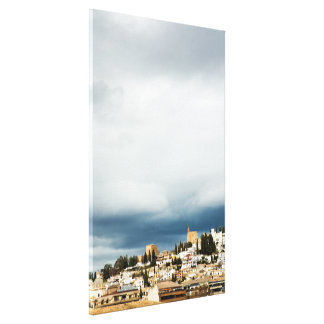 Skyline of the historic part of a city on a storm canvas print