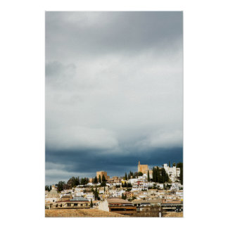 Skyline of the historic part of a city on a storm poster