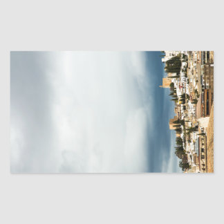 Skyline of the historic part of a city on a storm rectangular sticker