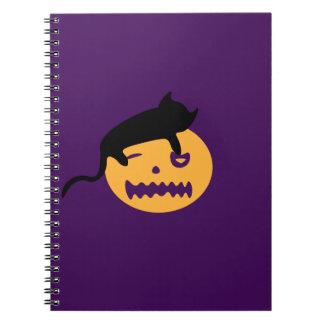 Sleeping cat on a pumpkin notebooks