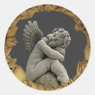 Sleeping Cherub Angel Sculpture Round Sticker. Round Sticker