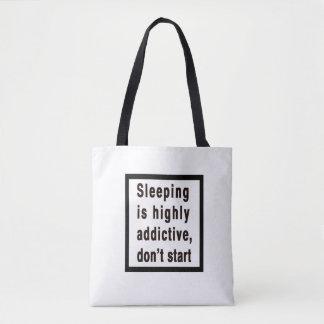 Sleeping is highly addictive... tote bag