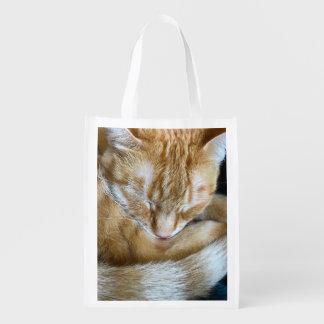 Sleeping orange tabby cat reusable grocery bag