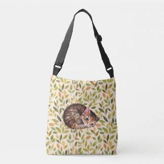 Sleepy cat, floral background crossbody bag