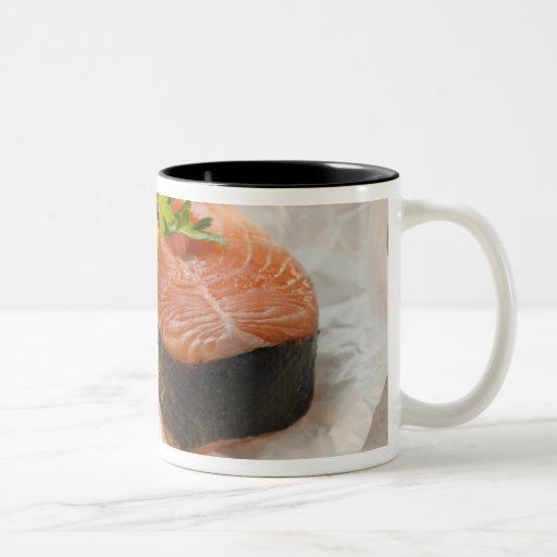 Slice of salmon on weight scale mug