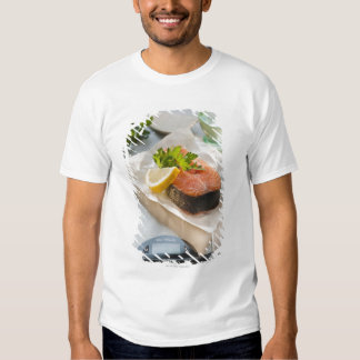 Slice of salmon on weight scale tees