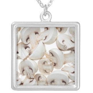 Sliced button mushrooms (agaricus bisporus), on custom necklace