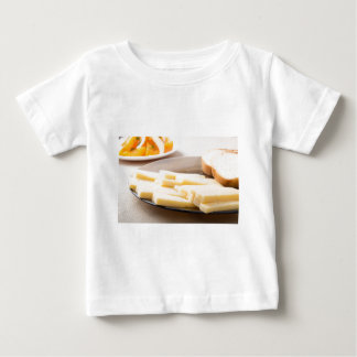 Slices of cheese and bread on a plate closeup baby T-Shirt