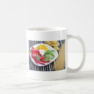 Slices of fresh raw vegetables coffee mug