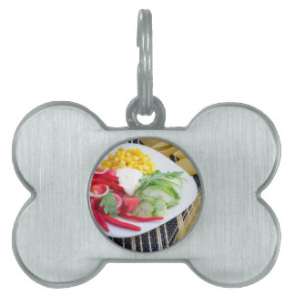 Slices of fresh raw vegetables pet tags