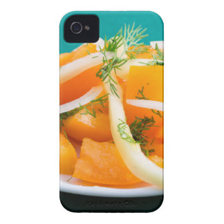 Slices of orange tomato on a plate with onions Case-Mate iPhone 4 cases
