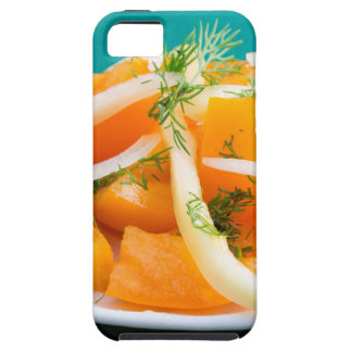 Slices of orange tomato on a plate with onions iPhone 5 covers