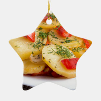 Slices of stewed potatoes and peppers on sackcloth ceramic ornament
