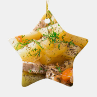 Slices of stewed potatoes, chicken, carrot ceramic ornament