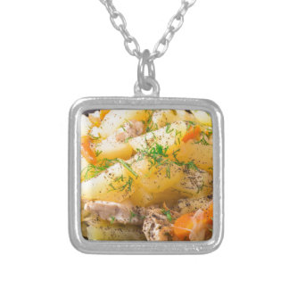 Slices of stewed potatoes, chicken, carrot silver plated necklace