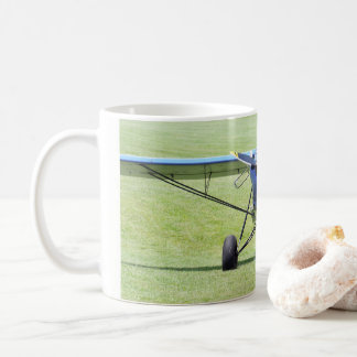 Small Airplane Parked On The Grass Coffee Mug