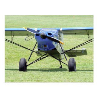 Small Airplane Parked On The Grass Postcard