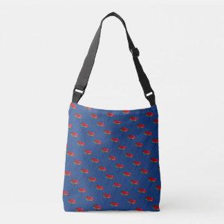 Small allover red blue poppy print on dark blue crossbody bag