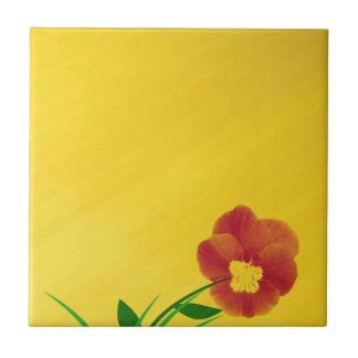 small bloom on golden underground ceramic tile