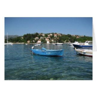 Small boat in sea off Kolocep, Croatia Note Card