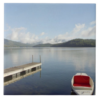 Small boat tied up on dock at Lake Placid Large Square Tile