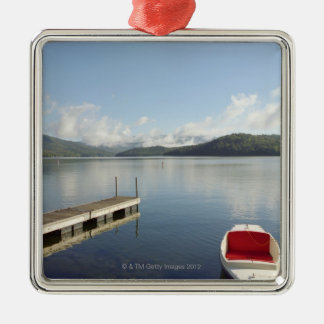 Small boat tied up on dock at Lake Placid Silver-Colored Square Decoration